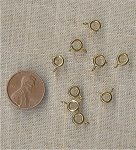 24 VINTAGE GOLD 7mm. ROUND SPRING CLASPS
